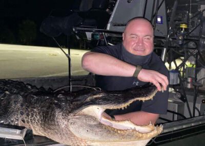 man holding gator mouth open