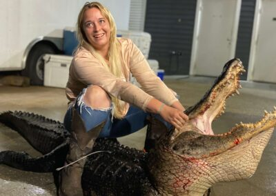woman posing after gator hunt in florida